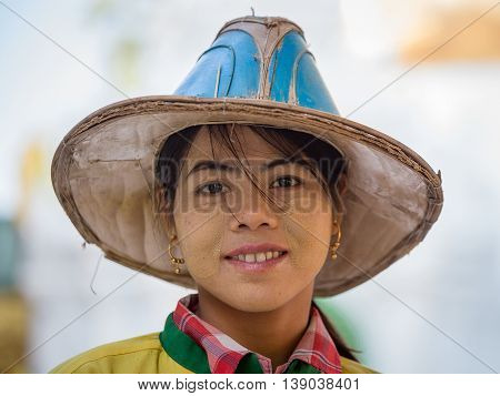 YANGON MYANMAR - FEBRUARY 01 2016: Unidentified Burmese girl visit the Shwedagon Pagoda. Shwedagon Pagoda is the most sacred Buddhist pagoda for the Burmese
