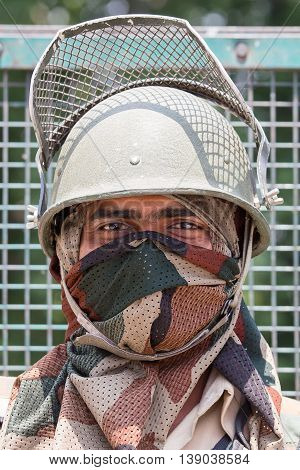 SRINAGAR INDIA - JUNE 11 2015: Unknown Indian frontier guard. Indian Army checkpoint in Kashmir Himalayas.