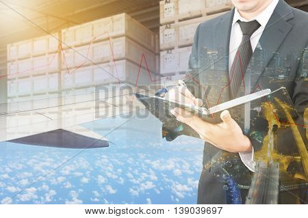 Double Exposure Of Businessman Checking Report And Business Center City With Blurred Cargo In Wooden