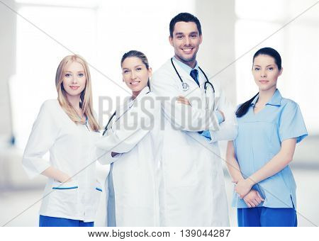 healthcare, hospital and medical concept - young team or group of doctors