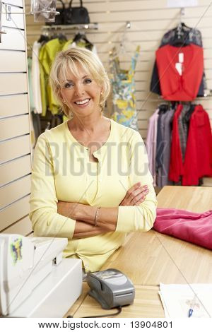 Female sales assistant in clothing store