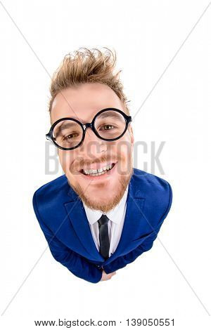 Funny smart guy in a suit and spectacles sugary smiles into the camera. Isolated over white.