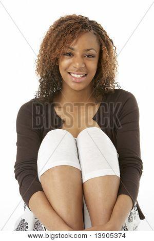 Studio Portrait Of Happy Teenage Girl