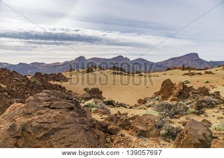 Igneous landscape with mountain range on background Teide National park Tenerife Spain