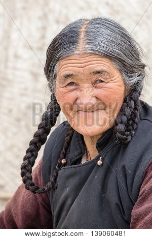 LEH INDIA - JUNE 24 2015: Unidentified tibetan old woman on the street in Leh Ladakh.
