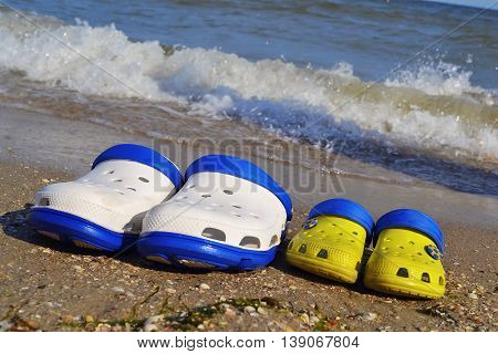 Two Pairs of white and small yellow slippers