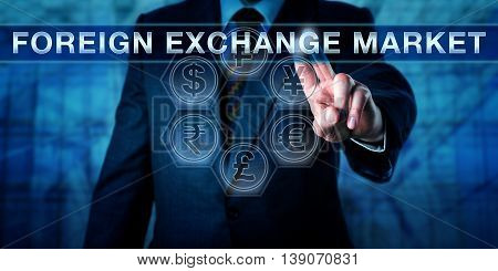Male trader is touching FOREIGN EXCHANGE MARKET on an interactive virtual control monitor. Business financial concept for FOREX FX interbank market and currency market. Close up torso shot.
