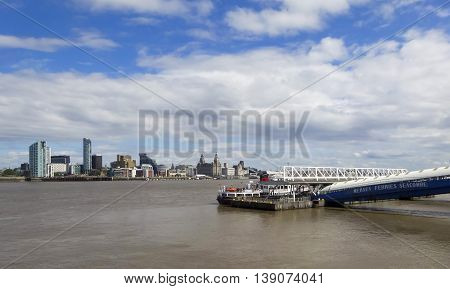 LIVERPOOL, ENGLAND, JULY 3. Pier Head from across the Mersey River on July 3, 2016, in Liverpool, England. Liverpool landmarks include The Royal Liver Building Merseyside Cunard Building Port of Liverpool Building Beetham Towers Alexandra Unity Residentia
