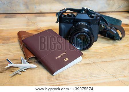 Travel item photo camera Passports on a wooden floor.