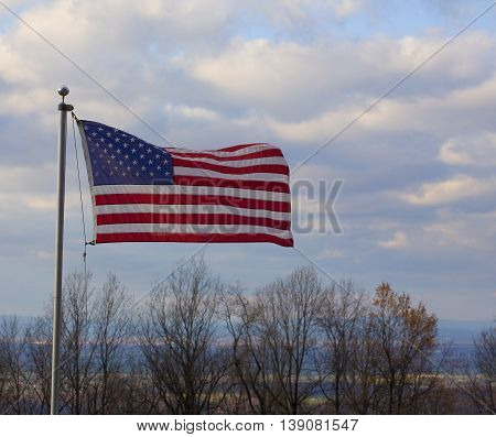 American flag waving in a breeze on the Blue Ridge over the Shenandoah Valley