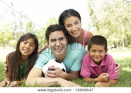 Family In Park With Football