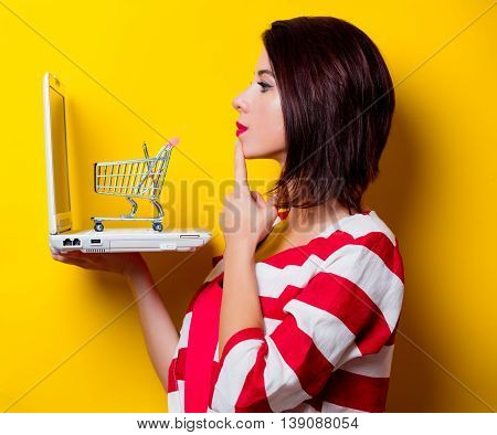 Young Woman With Cart And Laptop
