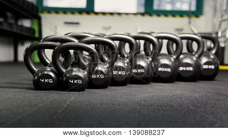 Sports dumbbells in sport club standing on the floor