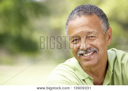 Portrait Of Senior Man In Park