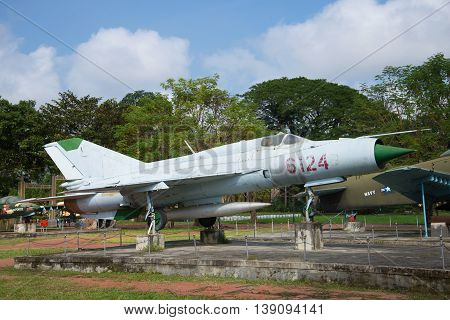 HUE, VIETNAM - JANUARY 08, 2016: The Soviet MIG-21 stands on a pedestal in the city of Hue. Historical landmark of the Vietnam