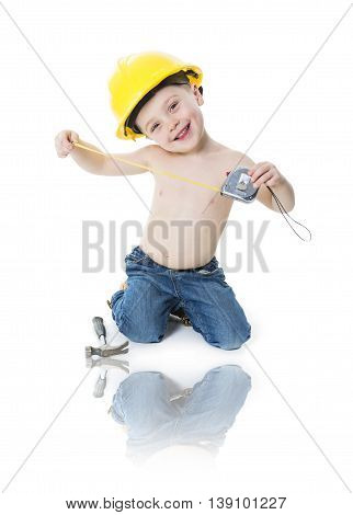 A child boy portrait wearing as a carpenter over a isolated white background