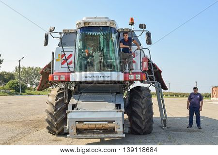 Russia Poltavskaya village - September 6 2015: Combine harvester combine operators with a parking lot. Agreecultural machines. Agreecultural equipment.