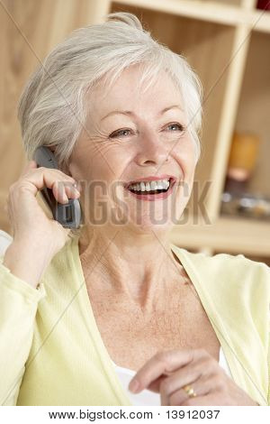Senior Woman Using Phone At Home