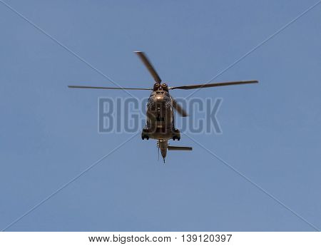 Paris France-July 14 2016 : The French military helicopter fly over Paris during Bastille Day military parade on Champs Elysees avenue .