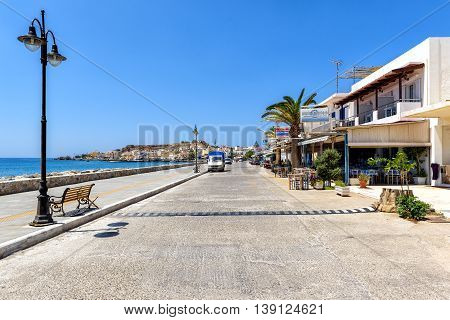 PALEOCHORA, CRETE, GREECE - JUNE 26, 2016: Promenade with tavernas at Paleochora town on Crete island