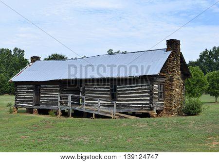 Old log cabin background at rural Georgia USA.