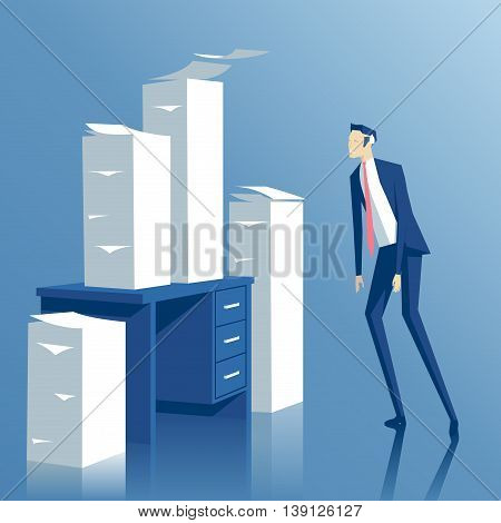 business concept paper work a tired businessman looking at the office desk with stacks of paper tired employee looks at the pile of papers on his table