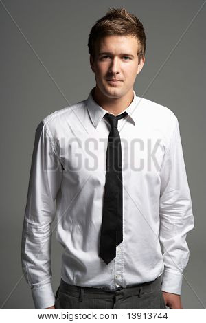Studio Portrait Of Young Man Wearing Shirt And Tie
