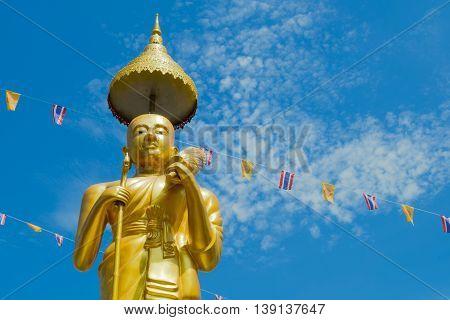 Samutprakarn, Thailand - July 19; Thai Buddhist decorate temple and Statue with Thailand flag and yellow Buddhism symbol flag to celebrating on Asalha Puja day before Khao Phansa day.