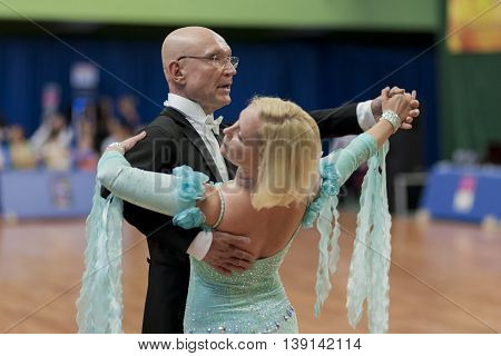 Minsk Belarus -May 29 2016: Senior Dance couple of Kaplin Anatoly and Zhudrik Ekaterina performs Adult European Standard Program on National Championship of the Republic of Belarus in May 29 2016 in Minsk Belarus