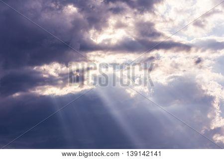 Sunbeam through the haze on blue sky, clud with sunlight