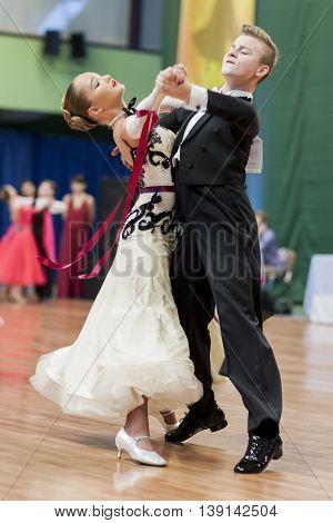 Minsk Belarus -May 29 2016: Danilevich Kevin and Dorosh Dariya Perform Juvenile-1 Standard European Program on National Championship of the Republic of Belarus in May 29 2016 in Minsk Republic of Belarus