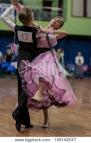 Minsk Belarus -May 29 2016: Tabolin Michail and Zhukovskaya Alina Perform Juvenile-1 Standard European Program on National Championship of the Republic of Belarus in May 29 2016 in Minsk Republic of Belarus