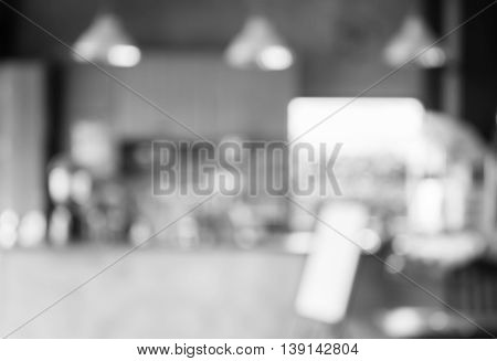 Black and white abstract blur coffee shop background, stock photo