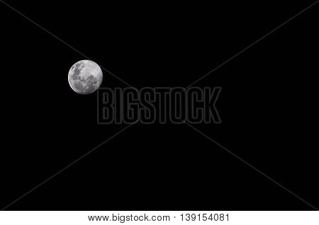 A full moon in a starless night sky