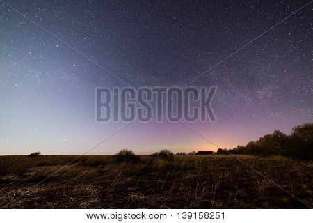 Beautiful Milky Way Galaxy On A Night Sky And Silhouette Of Tree With Cloud, Long Exposure