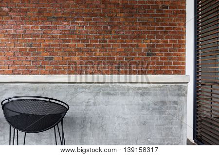 design of interior counter bar made from cement with iron seat bar stool and brick wall background