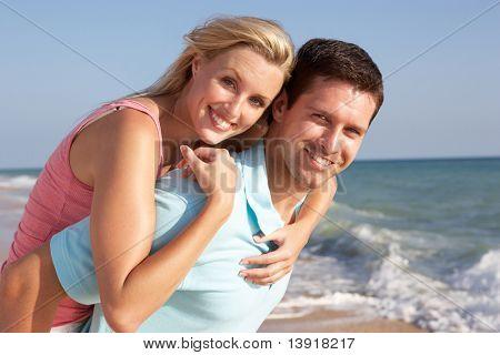 Young Couple Enjoying Beach Holiday