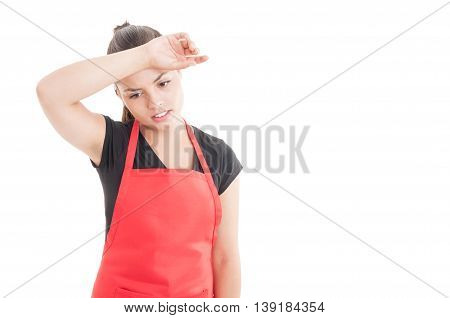 Exhausted Young Seller With Red Apron At Work