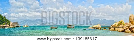 Landscape sea bay with moored boats, blue skies and cool sea surface very suitable for any resort where this beautiful Gulf