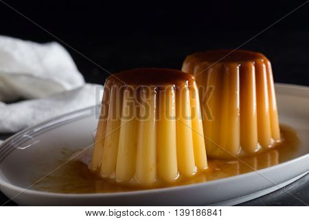 Creme brulee. Traditional French and Italian vanilla cream dessert with caramelized sugar. Delicious sweet tasty dish. Copy space