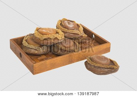 Dried abalone on bamboo tray in white background