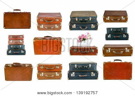 Collage of retro travel suitcases isolated on white. Set of old suitcases. Vintage baggage. Vintage travel bags. Pink flowers in jug on vintage suitcase. Pink roses. Shabby chic. Rustic concept.