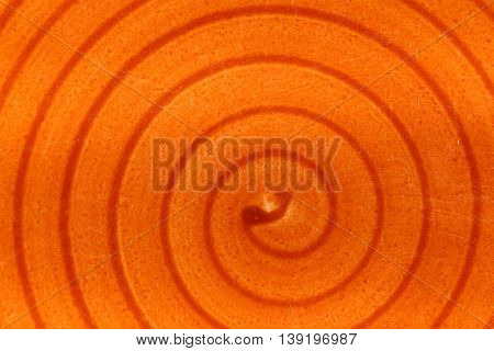 Orange varnish with spiral shape and saturated colors.