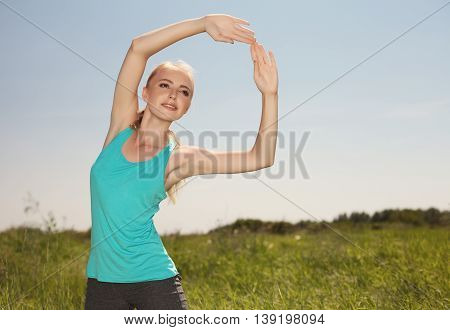 Beautiful  Blonde Woman Exercising In The Outdoors Yoga Photo On Nature