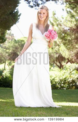 Bride Wearing Dress Holding Bouqet At Wedding poster