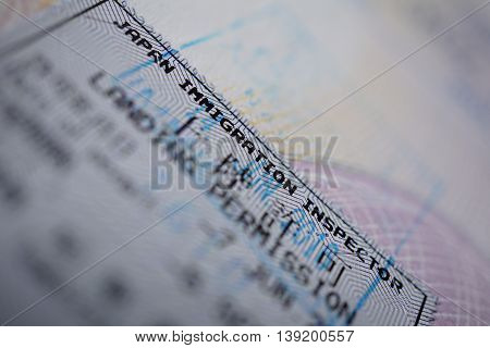 Printed passport stamp with a caption Landing permission in black ink as a part of Japanese Visa page