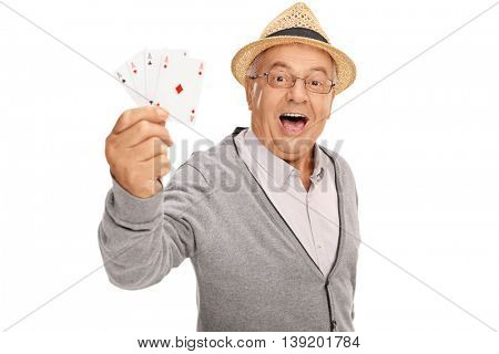 Elderly man playing cards and showing four aces isolated on white background