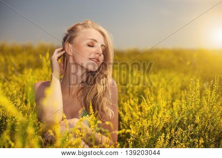 Blonde Sexy Young Beautiful Girl In The Field Yellow  Photo