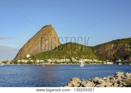 Botafogo Bay with their boats and the Sugar Loaf hill in Rio de Janeiro