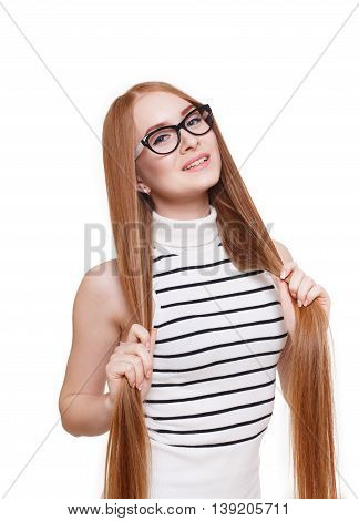 Redhead long-haired woman in eyeglasses. Young red ginger stylish girl in striped blouse with strong healthy hair. Beautiful attractive female portrait isolated at white background.